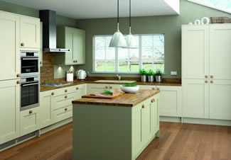 The rounded features of the Cranbrook in sage and stone make this kitchen especially welcoming