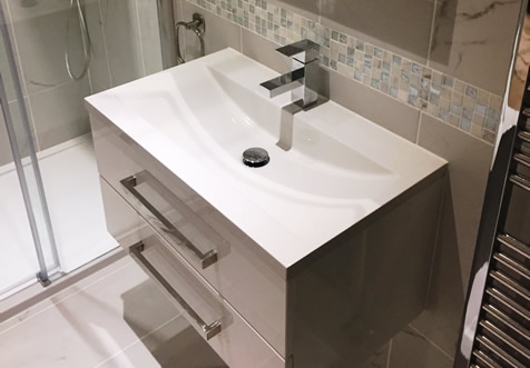 A recessed basin on a wall hung vanity with generous storage