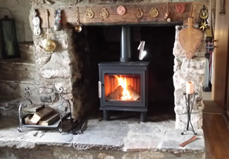 A Nordpeis Bergen very at home in a traditional inglenook fireplace