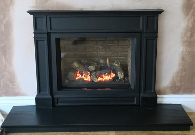 Yeoman CL5 gas stove with traditional beam and brick