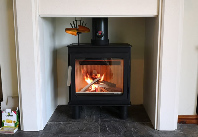Cleanburn Skagen stove with natural wood lintel